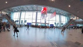 Passengers walking in departure hall at Domodedovo international airport. stock footage
