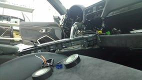 Moscow. February 2019. Premium car repair. Disassembled car interior Porsche 911. Repairing electronics, troubleshooting.  stock image