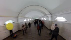 Rush hour in the subway, a crowd of people in the underground passage. Moscow - February 19, 2017: Rush hour in the subway, a crowd of people in the underground stock footage