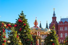 Moscow Festival Journey to Christmas . Illuminated New Year trees and Carousel on Manezhnaya Square in front of Historical Museum.  Stock Images