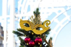 Moscow Festival Journey to Christmas . Illuminated New Year trees on Manezhnaya Square in front of Historical Museum. Golden carnival mask for decorating a Royalty Free Stock Photography