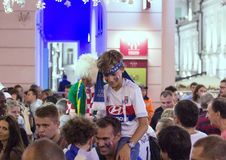 Moscow FIFA 2018. Emotions of football fans on Moscow streets. A boy with scarf on his head. stock image