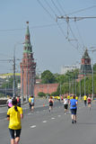 Moscow Half Marathon. Moscow, Russia - May 18, 2014: Runners on the distance of Moscow Half Marathon against Kremlin walls. It is the second race of the Moscow Royalty Free Stock Image