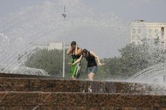Moscow. Hot summer. Girls in the big city fountain saved from heat. July 23, 2010. Moscow. Hot summer. Girls could not stand the heat, got into a big city Stock Image