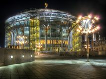 Moscow House of Music International Performing Arts Center at night. Peaceful scene with modern circular glass building and street lamps on foreground. High Stock Photography