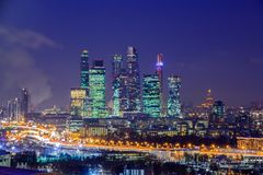 Moscow international business center `Moscow-city». Night or evening cityscape. Blue sky and street lights. Urban architecture stock photos