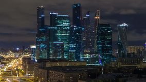 Moscow international business center Moscow City timelapse at night. Urban landscape metropolis night with skyscrapers. Aerial rooftop view stock footage