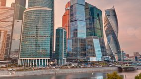 Moscow City skyline sunset time lapse zoom in. Moscow International Business Centre skyline with Moskva river in foreground stock footage