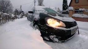 Moscow. January 2019. Black Volkswagen Golf hatchback car stuck in big snowdrift. Winter transport problems. Frozen automobile. stock footage