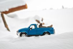 Moscow. January 2019. Blue toy Pickup truck Ford F350 in sawmill. Carrying fir cones. Sawdust in snow under wheels. Car in. Snowdrift royalty free stock photography