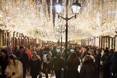 The Ilyinskaya street full of locals and tourists during Christmas time. Moscow-January 07: The Ilyinskaya street full of locals and tourists during Christmas stock photo