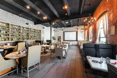 MOSCOW - JULY 2014: Interior of the modern pub restaurant in fusion style -. `JIMMYS PUB`. The former factory building royalty free stock images