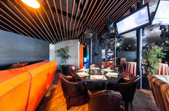 MOSCOW - JULY 2013: Interior of a modern restaurant SHAKTI TERRACE in the center of Moscow. The orange bar in the dance hall Royalty Free Stock Photo