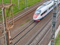 MOSCOW, JUN, 7, 2018: Diagonal view on high speed train Sapsan Velaro Rus runs on rail way tracks. Russian railways electric high stock photos