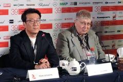 Film director and producer Youn Je Kuoyn and cinema expert Kirill Razlogov stock image