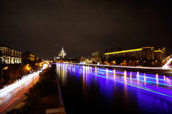 Moscow Kotelnicheskaya Embankment Building. Time-lapse. Moscow Kotelnicheskaya Embankment Building and ships on Moskva river at night. Time-lapse. September 17 Royalty Free Stock Photo