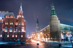 Moscow Kremlin cityscape. Russian old historical architecture: illuminated entrance into the Red Square in Moscow from the Manege square  (Manezhnaya ploshchad) Stock Photos
