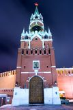 Moscow Kremlin tower. Old russian architecture: Spasskaya tower - the principal entrance to Kremlin at the Red Square in Moscow - by night with cloudy sky as a Stock Image