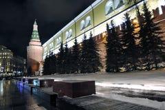 Moscow Kremlin and Alexanders garden at night. Color winter photo. Moscow Kremlin and Alexanders garden at night. Dark blue sky. People walk in Alexangers garden stock images