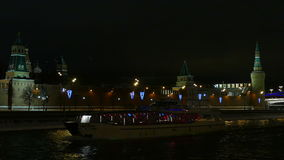 The Moscow Kremlin in the background riverboat evening swims in the winter stock video footage