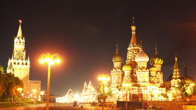 The Moscow Kremlin and the Basil`s Temple of Blessed at Night stock video