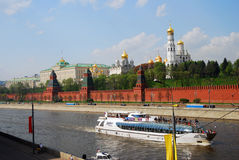 Moscow Kremlin. Big cruise ship sails on the Moscow river. Royalty Free Stock Images