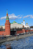 Moscow Kremlin. The Big Kremlin Palace with Russian state flag. Ice floats on the Moscow river embankment. UNESCO World Heritage Site stock photo