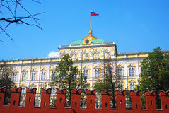 Moscow Kremlin. The Big Kremlin palace. Russian state flag. Moscow Kremlin. The Big Kremlin palace. Russian state flag waves on the roof top of the building on stock image