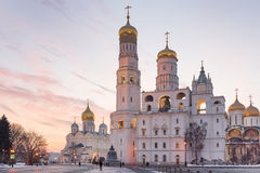 Moscow Kremlin cathedrals at sunset. Ivan the Great Bell tower and Kremlin Cathedrals at winter sunset in Moscow Stock Photos