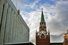 Moscow Kremlin. Concert Hall and old tower. Color photo. Royalty Free Stock Photo