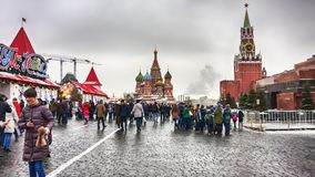 The Moscow Kremlin, crowd of people walking in the Red Square with the unic landscape of  of St. Basil`s Cathedral, Lenin`s maus. Moscow, Russian Federation Royalty Free Stock Image