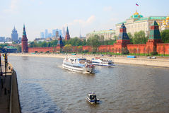 Moscow Kremlin. Cruis ships sail on the Moscow river. Royalty Free Stock Image