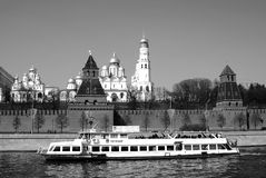 Moscow Kremlin, cruise ship sails on the Moscow river. Royalty Free Stock Images