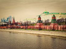 Moscow Kremlin, embankment of the Moscow river  and modern Moscow city in capital of Russian Federation at sunrise. Urban skyline.  Stock Photo