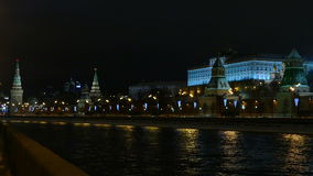 Moscow Kremlin embankment, street cars and in the evening - winter stock video footage