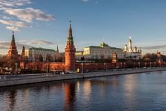 Moscow Kremlin Great Palaces and Churches from Moscow river at sunset. View of Moscow Kremlin Great Palaces and Churches from Moscow river at sunset royalty free stock images