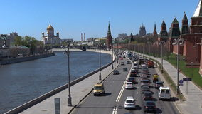 Moscow Kremlin and heavy trafic on the road. MOSCOW - MAY 4: Street scene with Moscow Kremlin and heavy trafic on the road on May 4, 2017 in Moscow, Russia.n stock footage