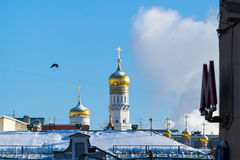 Moscow Kremlin Ivan the Great belfry and the city. Entrance to the Arbatskaya metro, subway, underground station. Architectural details and elements of Royalty Free Stock Photography