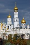 Moscow Kremlin. Ivan the Great Bell tower. Archangels church. UNESCO World Heritage Site. Blue sky with clouds background royalty free stock photos