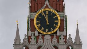 Moscow Kremlin Main Clock named Kuranti on Spasskaya Tower 12 hours . Red Square. Timelapse.  stock footage