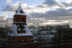 Moscow Kremlin and the Moscow river embankment. Color winter photo. Stock Photos