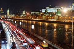 Moscow Kremlin, Moskva River and cars on road. Night cityscape royalty free stock images