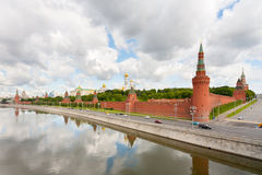 Moscow Kremlin on Moskva River coast on background of cloudy sky Stock Photo