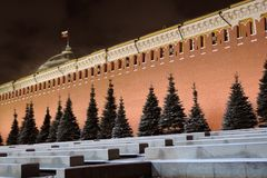 Moscow Kremlin at night. Color winter photo. Moscow Kremlin at night. Dark blue sky. Color night photo. Russian state flag tricolor waves on the roof top royalty free stock photos