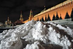 Moscow Kremlin at night. Huge snowhill. Color winter photo. Moscow Kremlin at night. Huge snowhill. Dark blue sky. Color night photo stock photo