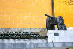 Moscow Kremlin. Old cannons put along the yellow wall. Stock Photo