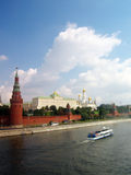 Moscow Kremlin panorama. Cruise ship sails on the Moscow river. MOSCOW - AUGUST 03, 2014: View of Moscow Kremlin. A popular touristic landmark, UNESCO World Royalty Free Stock Photography