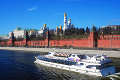Moscow Kremlin panorama. Cruise ship sails on the Moscow river. Moscow Kremlin panorama. UNESCO World Heritage Site. Cruise ship sails on the Moscow river. Blue Stock Photo