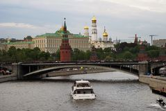 Moscow Kremlin panorama. Cruise ships sails on the river. Moscow Kremlin is a UNESCO World Heritage Site. Blue sky background Stock Photo
