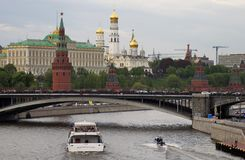 Moscow Kremlin panorama. Cruise ships sails on the river. Moscow Kremlin is a UNESCO World Heritage Site. Blue sky background Stock Image